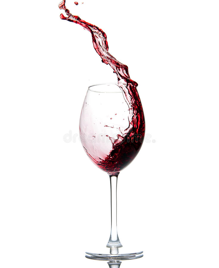 Pouring Red Wine. Isolated on white royalty free stock image