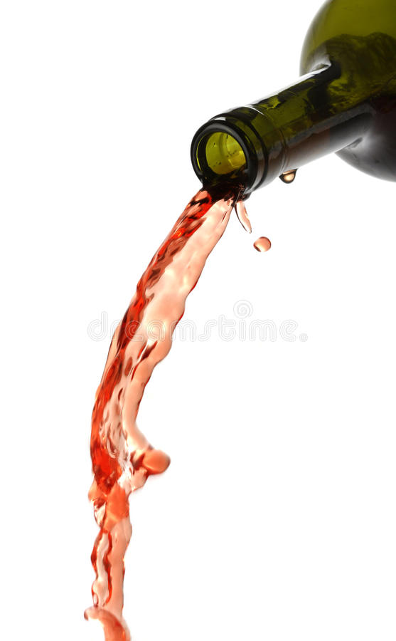 Pouring red wine, liquid falling. Isolated on white royalty free stock image