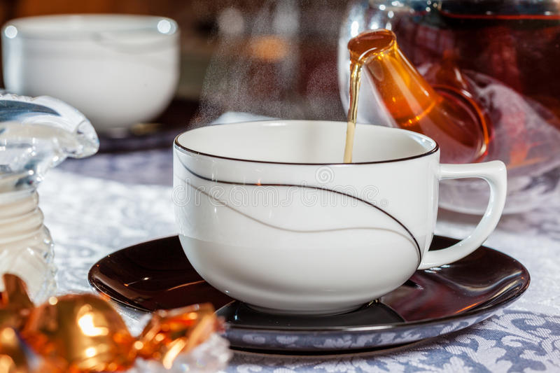 Download Pouring tea stock photo. Image of steam, candy, closeup - 42087652