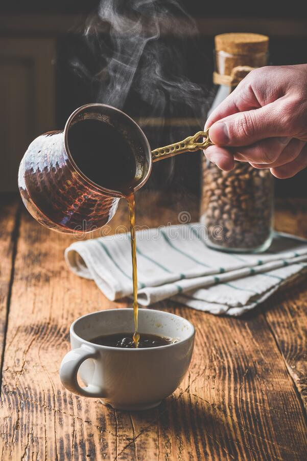 Free Pouring Turkish Coffee Into White Cup Stock Image - 199210781