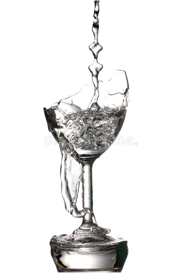 Pouring water in the a broken glass, on white. Pouring water in the a broken glass, isolate on white background stock photos
