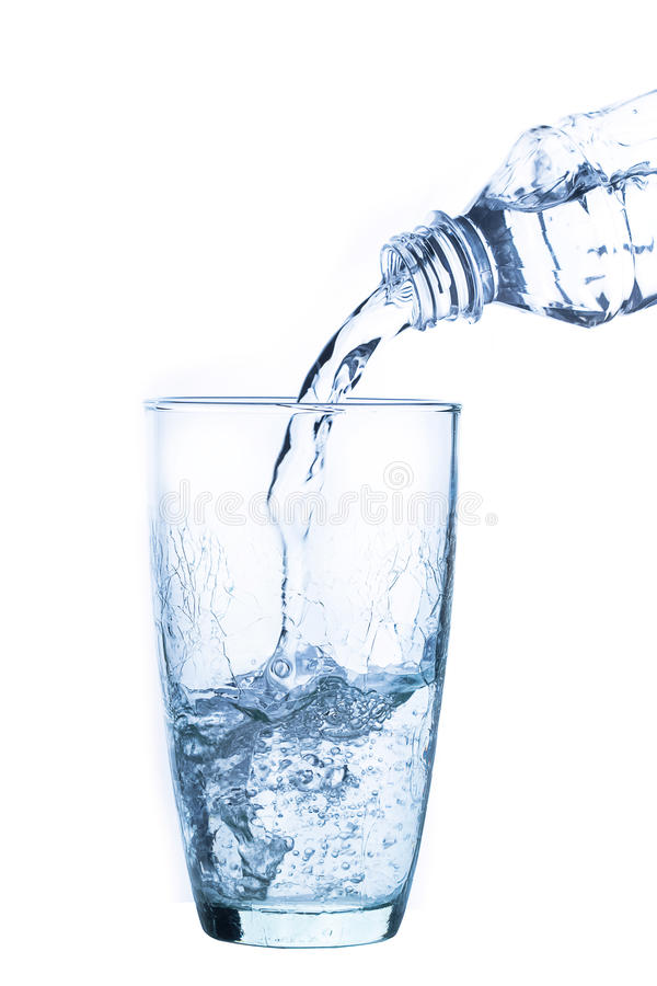 Pouring water into glass stock images
