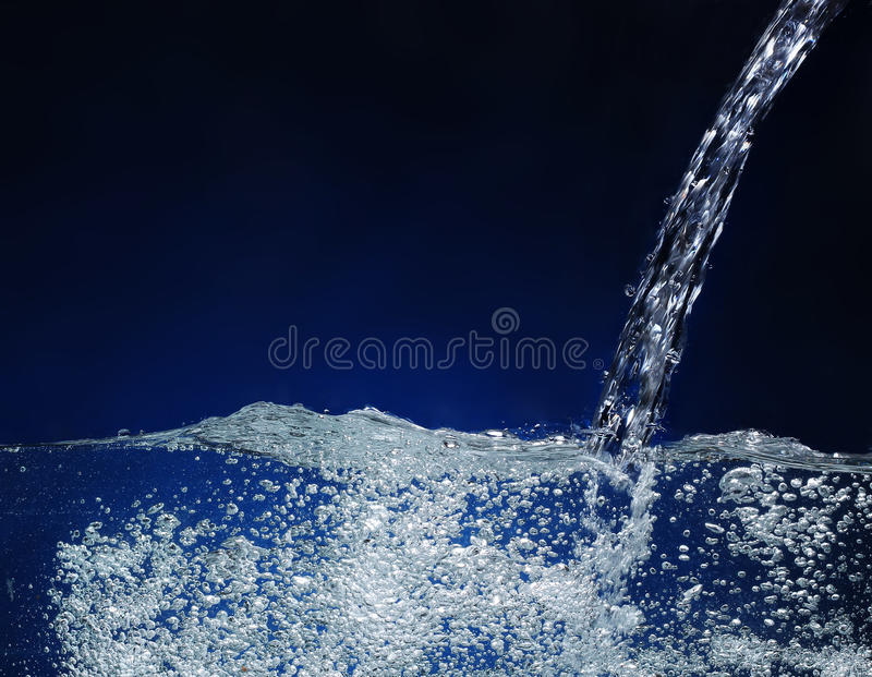 Download Pouring water  Splash stock photo. Image of splashing - 25177856