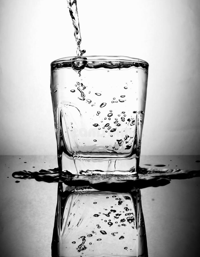 Pouring water to glass royalty free stock photos