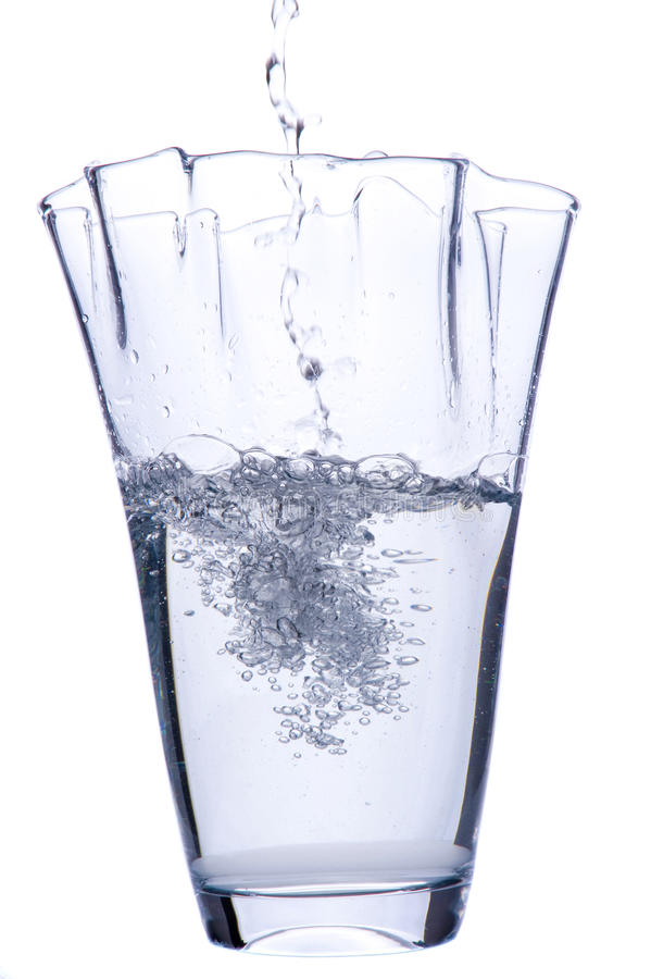 Pouring water to vase royalty free stock image