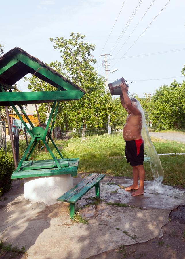 Pouring water from a well is a very useful and healthy treatment royalty free stock image