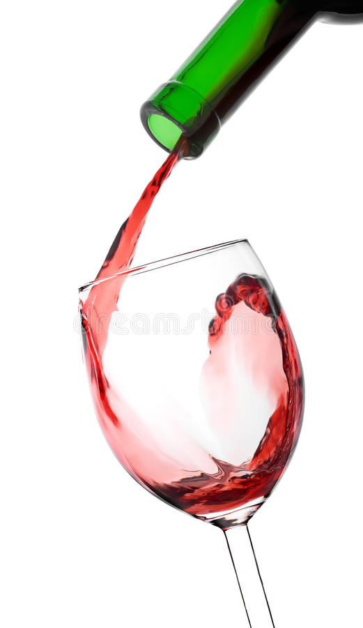 Pouring wine. Pouring red wine in the glass from bottle royalty free stock photos