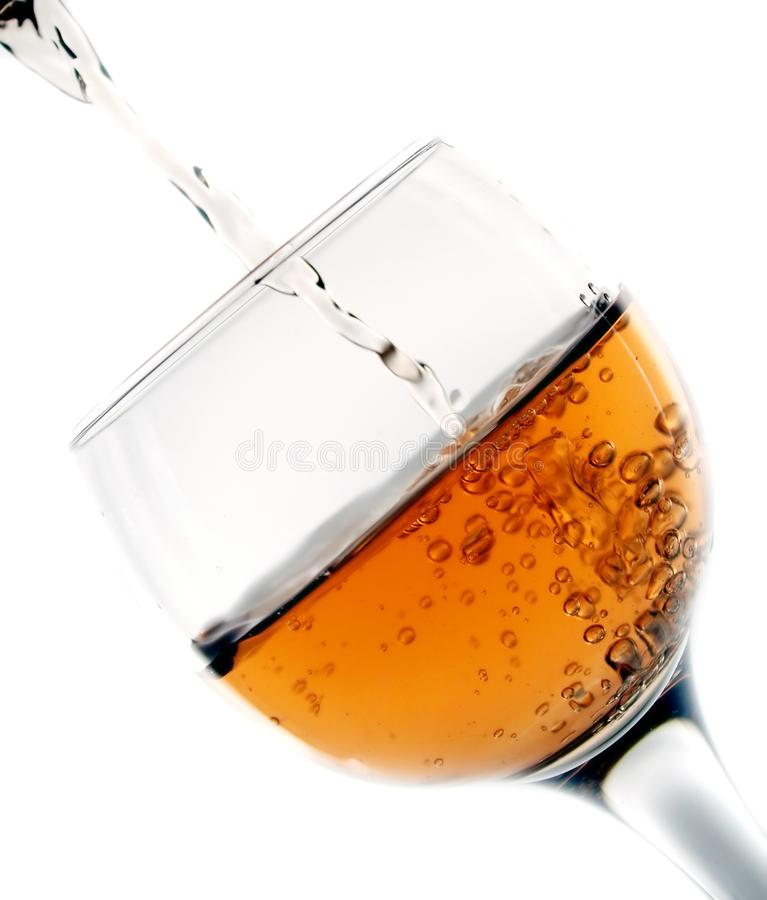 Pouring wine in glass royalty free stock photography
