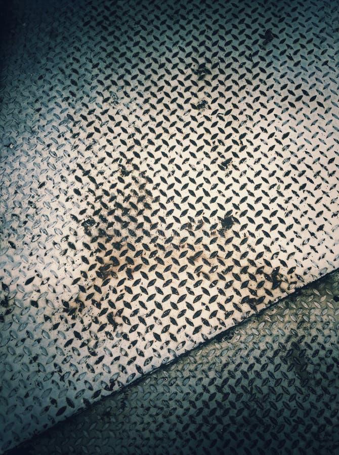 Pousse de plaque métallique antique dans le bleu photos stock