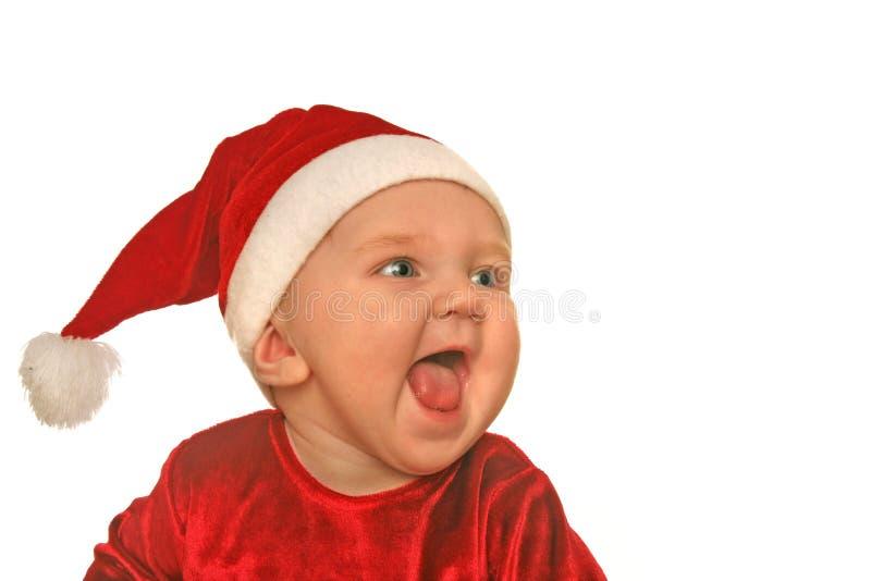 Pousser des cris perçants de chéri de Noël images stock