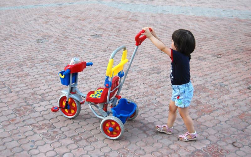 Poussez le tricycle photo libre de droits