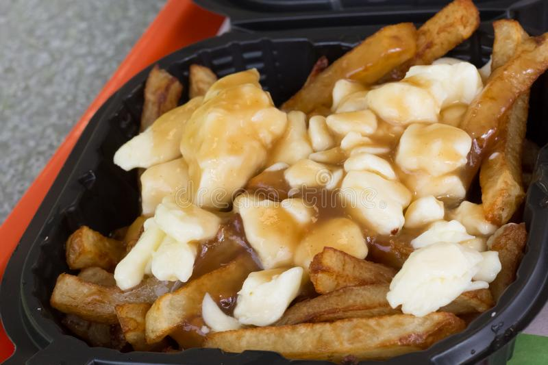 Poutine - French Fries Cheese Curds Gravy royalty free stock photos