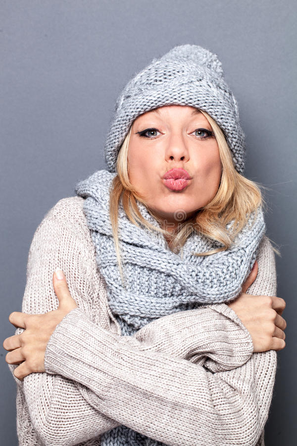Pouting beautiful young blond woman feeling for valentines day stock image
