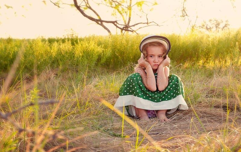 Pouting girl. A pouting girl with green polka dot dress royalty free stock photo