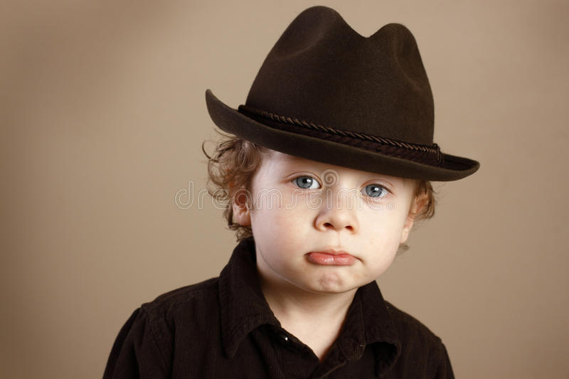 Download Pouting Toddler With Fedora Stock Photo - Image: 24285350