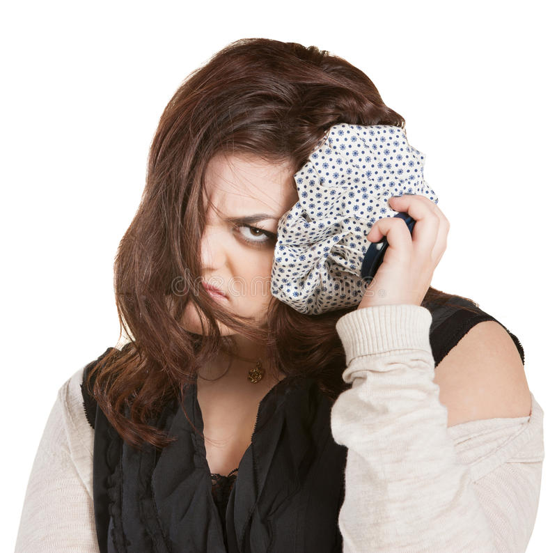 Angry Woman with Ice Pack. Pouting young lady with ice pack on head stock photos
