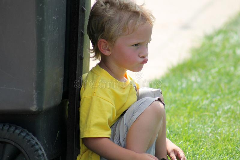 Pouty Toddler Boy. Little Toddler boy pouting in the grass stock image