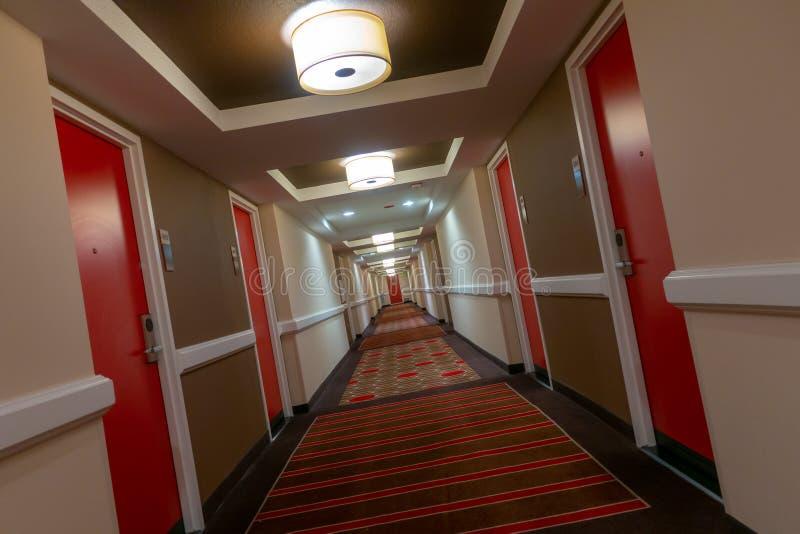 POV av att gå i lång korridor royaltyfri foto