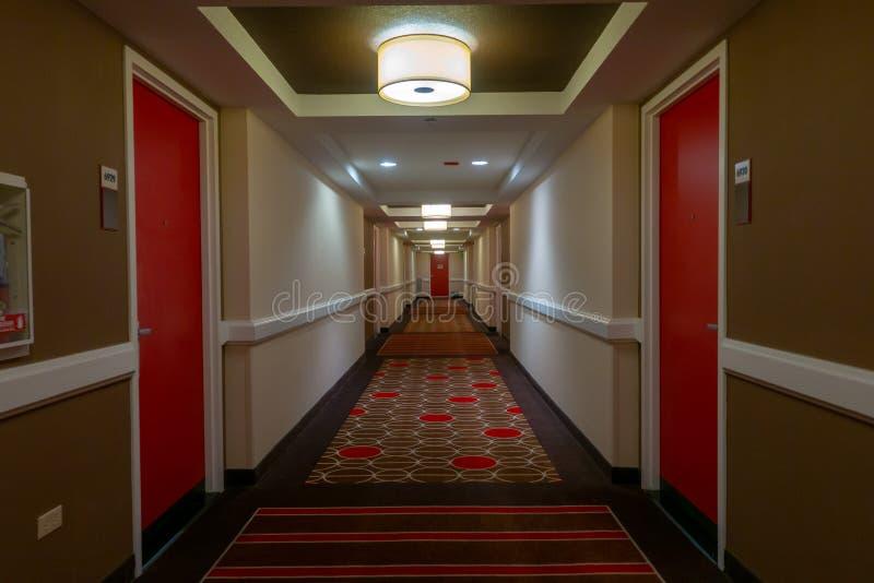 POV av att gå i lång korridor royaltyfri bild