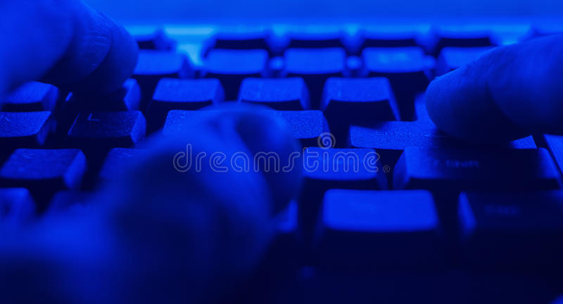 POV computer hacker attacks bank system. Hands typing on pc desktop computer keyboard. Cyber hacker attack concept stock image