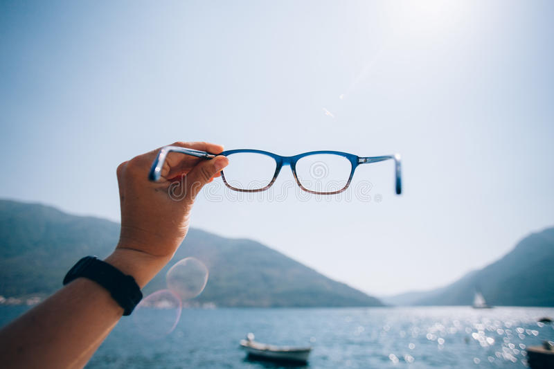 POV woman hold prescription glasses royalty free stock photos