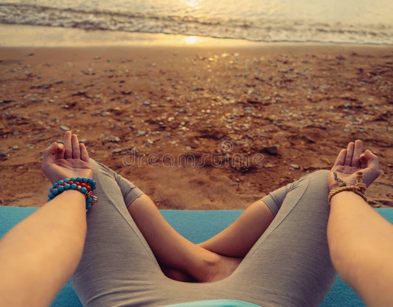 POV image of woman meditating in pose of lotus royalty free stock image
