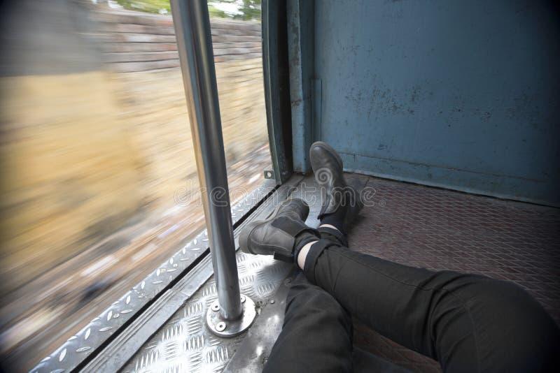 POV Traveler reclines in train carriage stock photos
