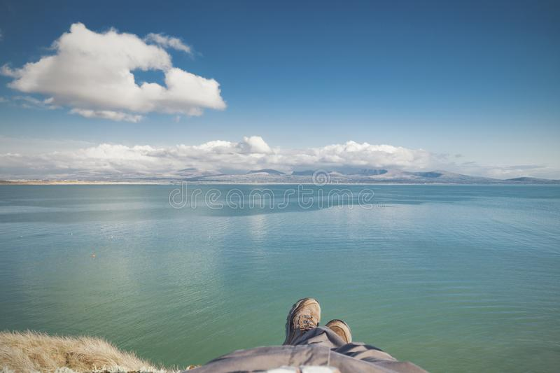 Chilling Under the Colouds on Cliffs of Tidal Island at Bright S royalty free stock images