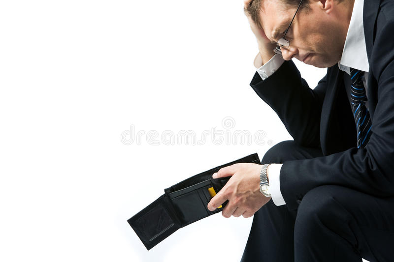 Poverty. Image of sad businessman holding empty wallet and grieving stock photography