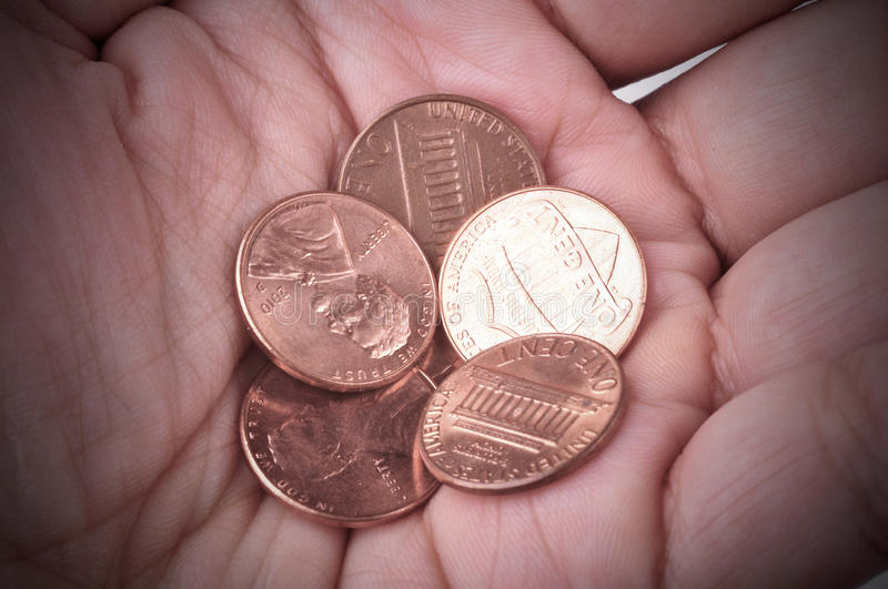 Poverty. Hand holds some coins. Concept of poverty stock photography
