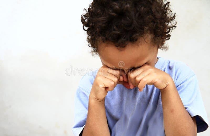 Poverty boy crying stock photos