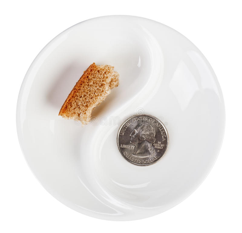 Poverty concept photo with quarter dollar. Coin and bread crust on white plate royalty free stock photos
