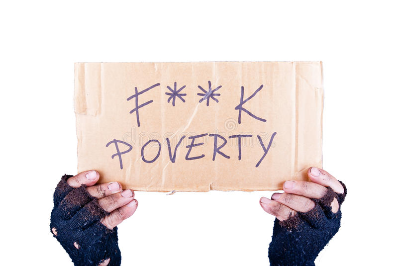 Poverty. Dirty hands in black ruined gloves holding cardboard with expressive message against poverty, isolated stock image