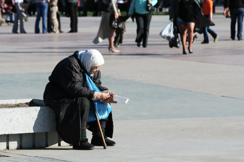 Poverty poor old woman on city street royalty free stock photos