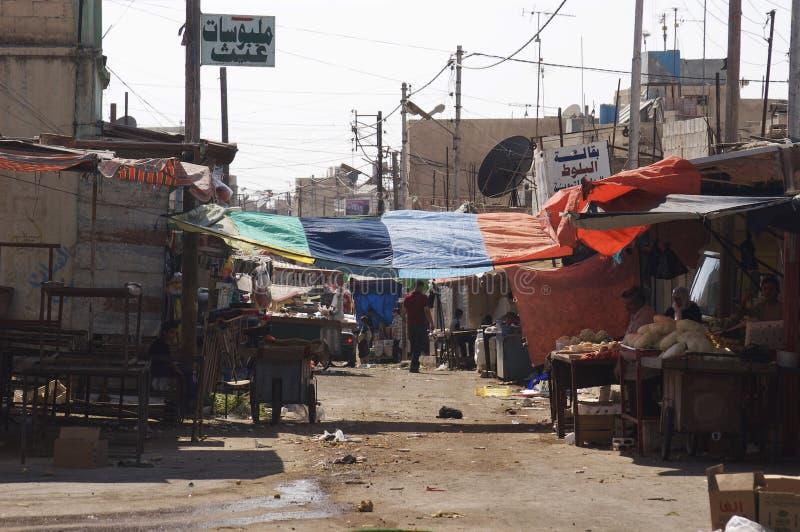 Refugee camp in Irbid, Jordan. Poverty shows in this street scene of a market in Irbid, Jordan stock photos