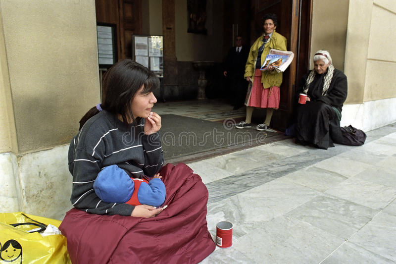 Poverty among women in Buenos Aires, Argentina. Argentina, province, capital, city Buenos Aires: in front of the main entrance of the Catholic Metropolitan royalty free stock photography
