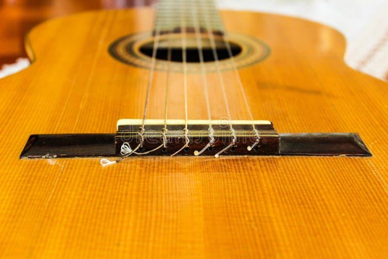 Povos do instrumento do close up do sumário do detalhe da guitarra imagens de stock royalty free