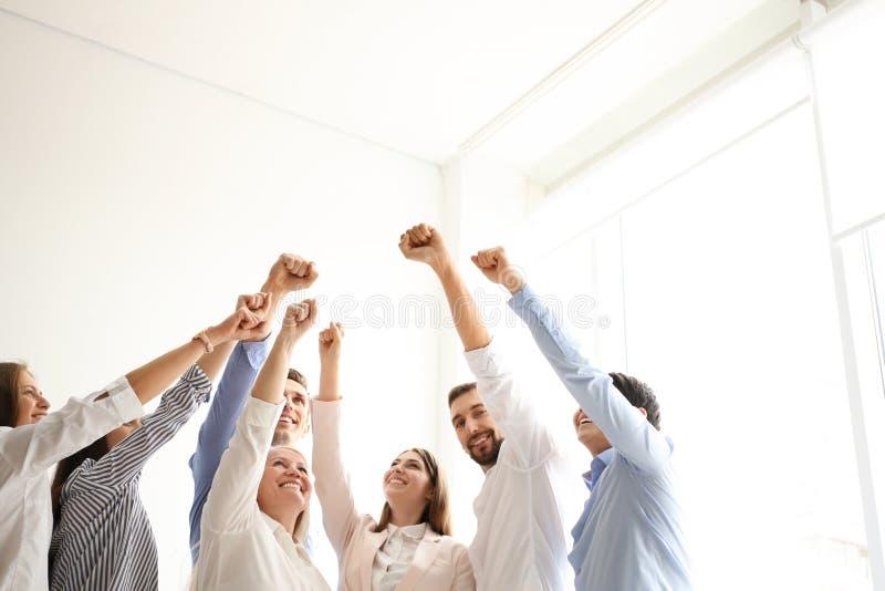 Povos que aumentam os punhos junto dentro imagem de stock royalty free