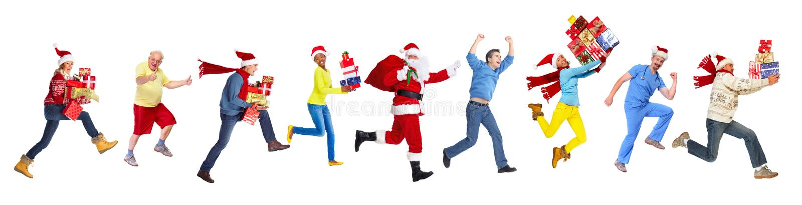 Povos running felizes do Natal fotografia de stock