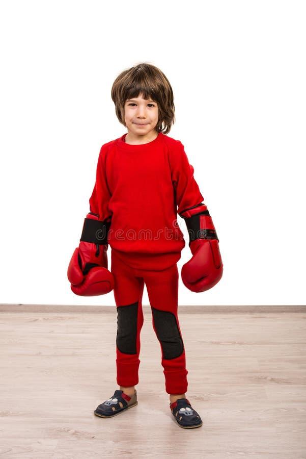 Poważna chłopiec jest ubranym bokserskie rękawiczki obrazy royalty free