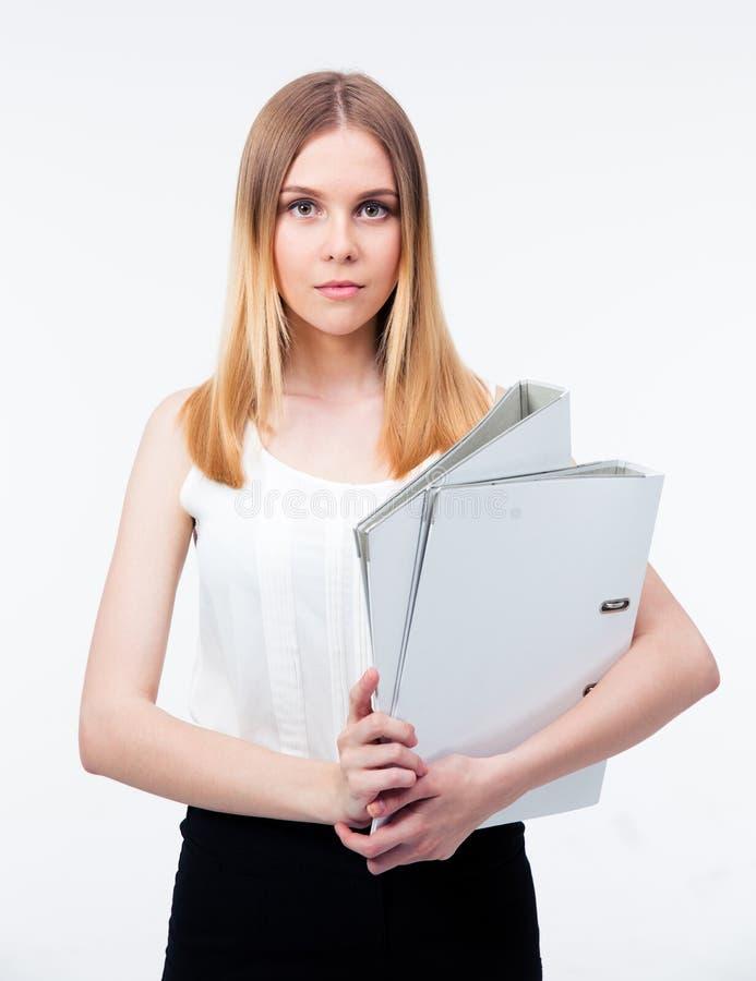 Poważne młode biznesowej kobiety mienia falcówki zdjęcie royalty free