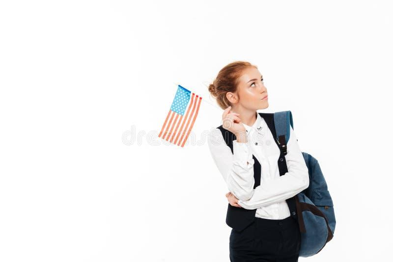 Poważnego zadumanego gigner studencka kobieta z plecaka mienia usa flaga obraz stock