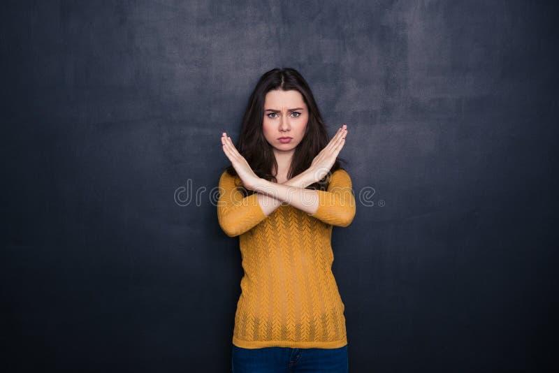 Poważny kobieta seansu przerwy znak z krzyżować palmami zdjęcie royalty free