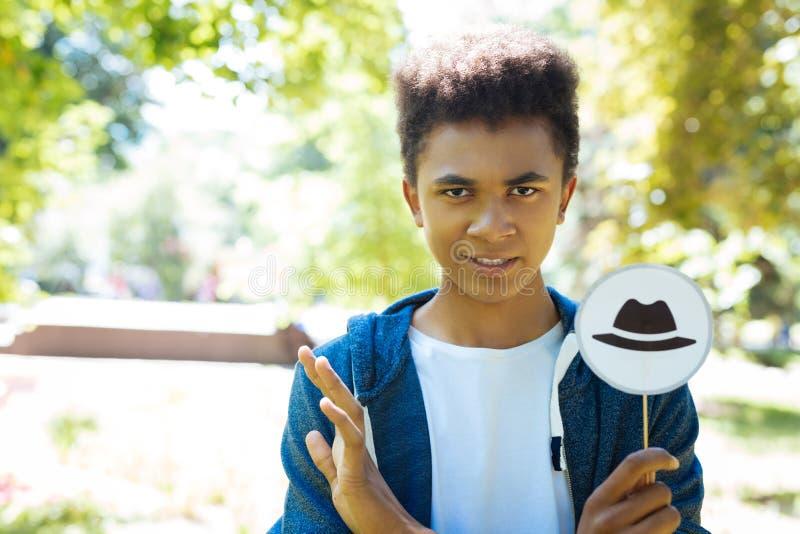 Poważny uczeń ma pesymistycznego widok o przyszłości jego kraj zdjęcie royalty free