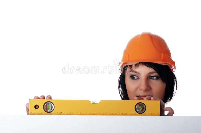 Powabna dziewczyna budowniczy zdjęcia stock
