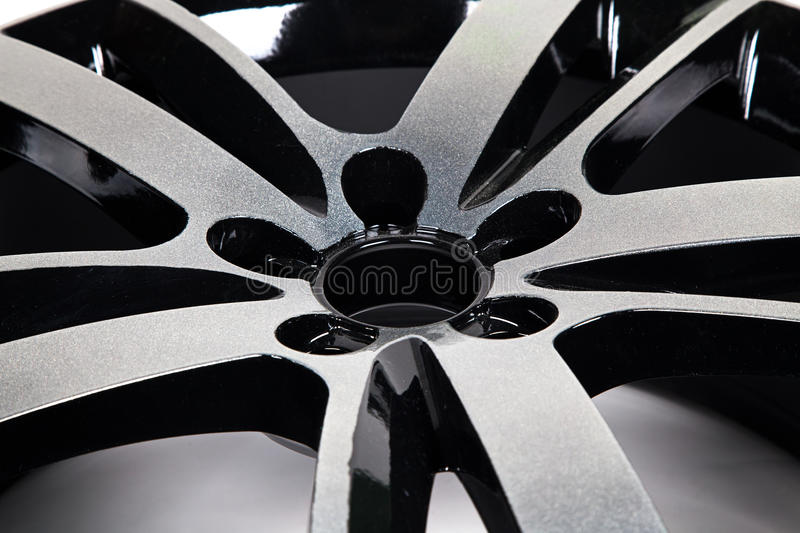 Powder coating of black wheel disk. Close up royalty free stock image