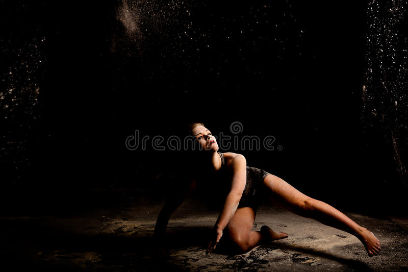 Powder dancer ground action low key royalty free stock photography