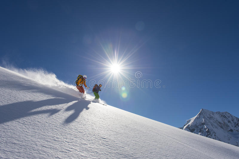 Powder downhill skiing stock photos
