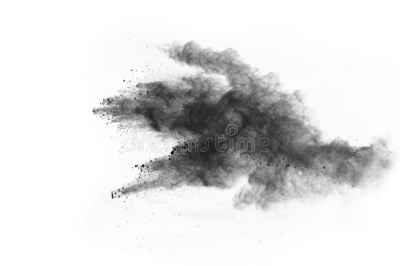 Powder explosion. Closeup of a black dust particle explosion isolated on white. Abstract background. stock images