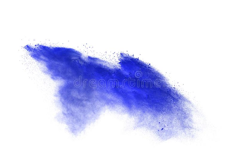 Powder explosion. Closeup of blue dust particle explosion isolated on background.  royalty free stock images